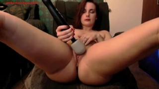 redhead uses toy on webcam